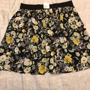H & M skirt. New black flowers. A line short